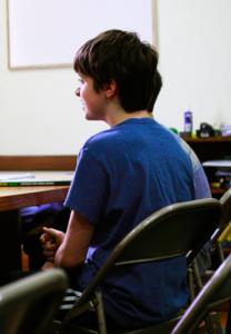 Cassius sitting in class