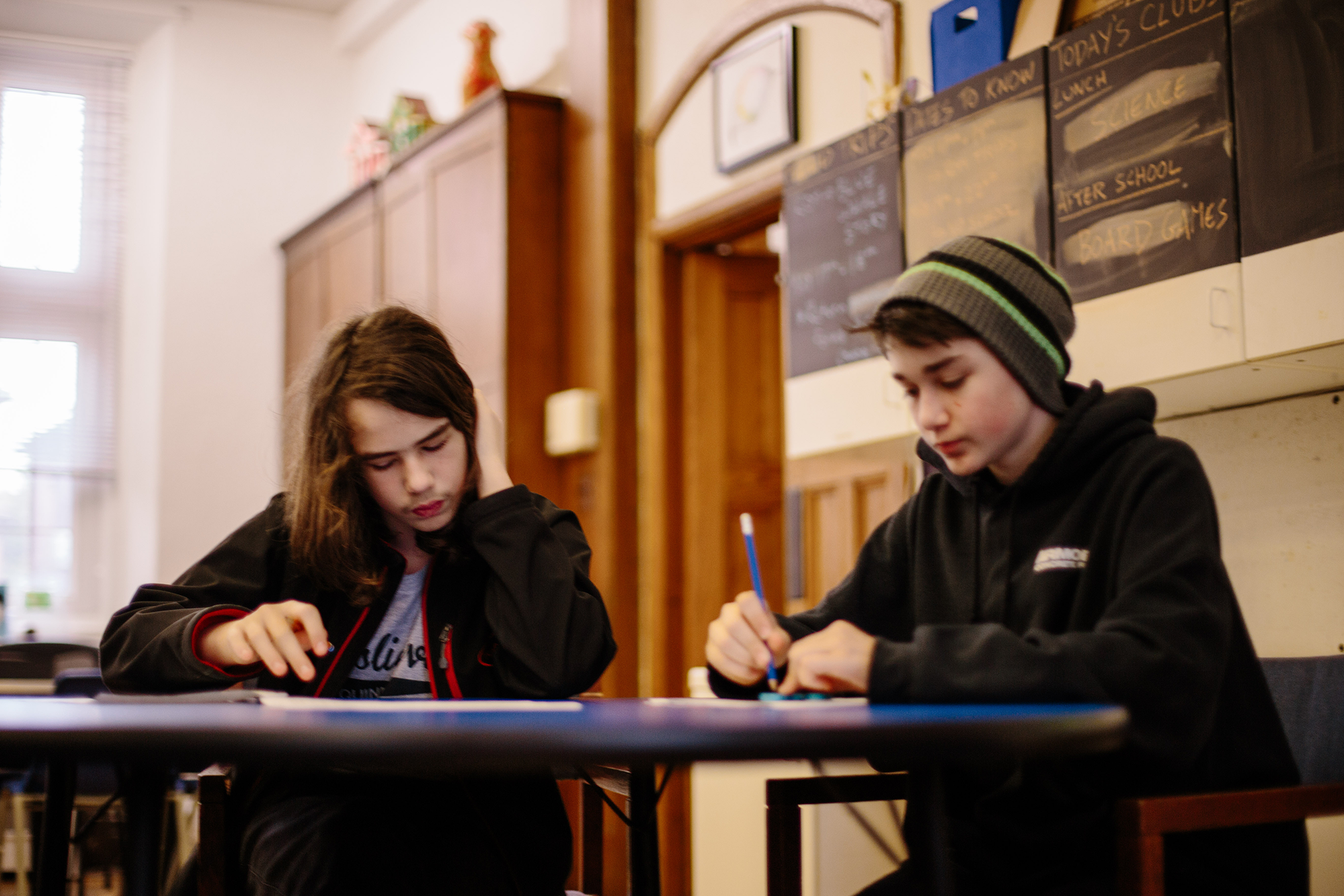 Two students, studying together at a desk
